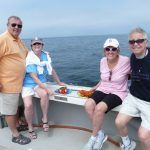 4 people onboard lobster tour boat