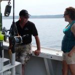 captain and woman talking onboard lobster tour