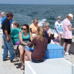 group of people on boat for lobster tour